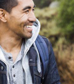 a_young_man_smiling__qqFkQ.jpg